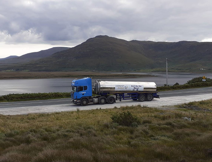 Distant view of Campions water lorry on the move